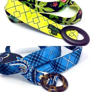Two Vera Bradley cloth belts with enamel buckles